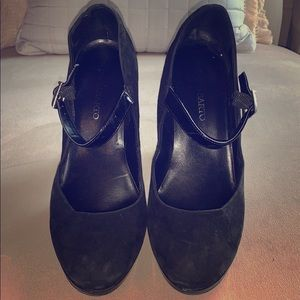 Suede black Mary Janes.